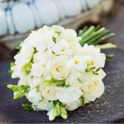 Brides bouquet of Avalanche Roses, Freesia and Ranunculus