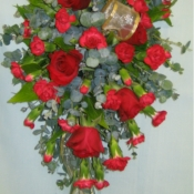 Pew end of Red roses, Carnations and Eucalyptus