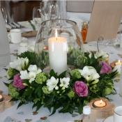 Table centre of Cool-water Roses, Freesia, Ranunculus and Viburnum